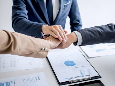 image-of-business-people-joining-and-putting-hands-together-during-their-meeting-connection-and_t20_7mWYj4.jpg